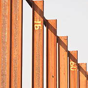 orange steel girders with yellow lettering and white background
