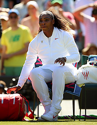 Serena Williams takes her seat ahead of her match on day One of the Wimbledon Championships at the All England Lawn Tennis and Croquet Club, Wimbledon.