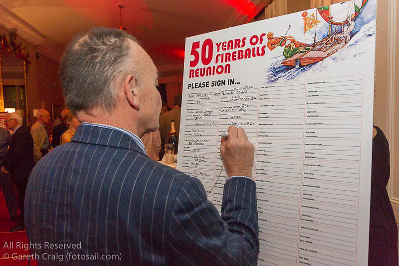 Pete Evans signing one of the boards at the reunion night to celebrate 50 years of the Irish Fireball Class, held at the Royal St George YC.