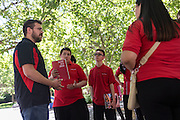 Patrick Arite talks with a group prospective students while giving a campus tour on Thursday June 2, 2016. Arite and Nezzersare (not pictured) are both students at the University of New Mexico and are working 15-30 hours per week giving campus tours in order to help put themselves through college. (Steven St. John for NPR)