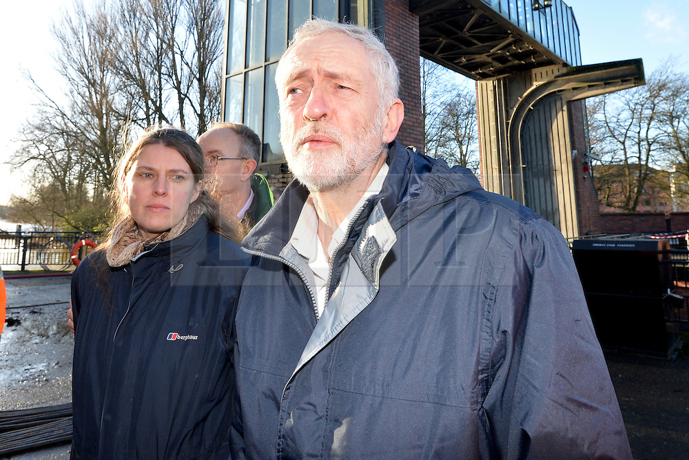 © Licensed to London News Pictures. 31/12/2015. York, UK. Labour Party leader Jeremy Corbyn with York Central MP Rachael Maskell visiting the Foss Barrier where the Rivers Foss and Ouse meet in York. Photo credit : Anna Gowthorpe/LNP