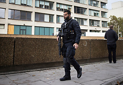 © Licensed to London News Pictures. 13/10/2020. London, UK. An armed police officer is seen outside St Thomas' Hospital during an incident which is believed to now be contained. Photo credit: Peter Macdiarmid/LNP