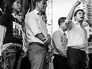 05 AUGUST 2013 - BANGKOK, THAILAND: Former Thai Prime Minister ABHISIT VEJJAJIVA speaks at a Thai Democrats' event in Bangkok Monday. Abhisit spoke at a gathering of Thai Democrats in a working class neighbohood of Bangkok off of Rama VI Road. He spoke out against the Pheu Thai's amnesty efforts, which could lead to Thaksin Shinawatra returning to Thailand.     PHOTO BY JACK KURTZ