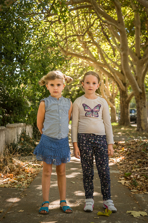 """Five year old Lucia stands with her friend, Ella, on Cedar Street in  Calistoga.  """"They had their first sleep-over last night...Ella decided to go home at 11 PM...but she came back for breakfast.""""  -Molly Bastine (Lucia's mother,)"""