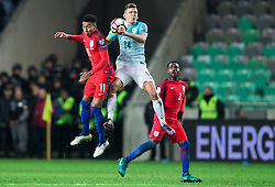 Jesse Lingard of England vs Roman Bezjak of Slovenia during football match between National teams of Slovenia and England in Round #3 of FIFA World Cup Russia 2018 Qualifier Group F, on October 11, 2016 in SRC Stozice, Ljubljana, Slovenia. Photo by Vid Ponikvar / Sportida