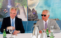 Environmental specialist Justin Mundy (left) with the Prince of Wales in a Blue Economy Roundtable meeting at the Spice Island Beach Resort during a one day visit to the Caribbean island of Grenada.
