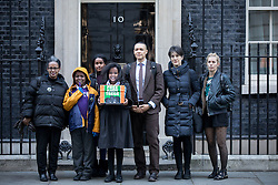"""© Licensed to London News Pictures. 29/11/2016. London, UK. Yemi Hailemariam, Yilak Andargachew, Helawit Hailemariam, Menabe Andargachew, Clive Lewis MP, Dame Harriet Walter and Sara Pascoe [Left to Right] bring a petition to Downing Street calling on the Prime Minister to seek the release of British man Andargachew """"Andy"""" Tsege, who is in his sixties, who is in prison in Ethiopia under the shadow of a death sentence. Andargachew Tsegehas been detained in the country since he was removed from an airport in Yemen in June 2014. The father-of-three, who fled the country in the 1970s and sought asylum in the UK in 1979, had been a prominent critic of Ethiopia's ruling party. Photo credit : Tom Nicholson/LNP"""