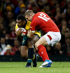 Samu Kerevi of Australia is tackled by Hadleigh Parkes of Wales<br /> <br /> Photographer Simon King/Replay Images<br /> <br /> Under Armour Series - Wales v Australia - Saturday 10th November 2018 - Principality Stadium - Cardiff<br /> <br /> World Copyright © Replay Images . All rights reserved. info@replayimages.co.uk - http://replayimages.co.uk