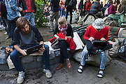 Moscow, Russia, 15/05/2012..Protesters using laptop computers in Chistiye Prudy, or Clean Ponds, as a Moscow court ordered the eviction of some 200 opposition activists who have set up camp in the city centre park.
