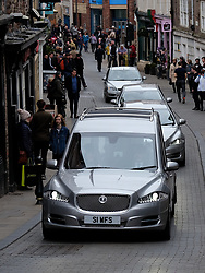 © Licensed to London News Pictures. <br /> 17/03/2017<br /> DURHAM, UK.  <br /> <br /> The funeral cortege of Game of Thrones actor NEIL FINGLETON drives through Durham City ahead of his funeral at Durham Cathedral.<br /> <br /> The 36-year old died suddenly last month at his home in Gilesgate, Durham. He was the UK's tallest man and a former professional basketball player. He turned to acting and played a giant, Mag the Mighty, in the Game of Thrones series.  <br /> <br /> Photo credit: Ian Forsyth/LNP