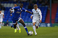 Alfie Potter of Northampton Town under pressure from Ousmane Fané of Oldham Athletic during the EFL Sky Bet League 1 match between Oldham Athletic and Northampton Town at Boundary Park, Oldham, England on 16 August 2016. Photo by Simon Brady.