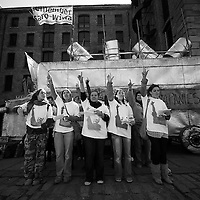 """This was the launch of the 'Remember Saro-Wiwa', a 3 day event at Albert Dock. Music was provided by Liverpool's Hope Collective who are pictured here by the Living Memorial. The Living Memorial is a hand built 12ft high by 18ft long Nigerian steel Bus by Sokari Douglas-Camp, with a quote from Ken Saro-Wiwa on it. """"I accuse the oil companies of practising genocide against the Ogoni."""" Ken Saro-Wiwa was executed along with 8 others on the 10th November 1995 following their campaign to stop the environmental devastation of the Ogoni area of the Niger Delta."""