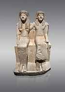 Ancient Roman statue of Pendua and his wife Nefertari, limestone, New Kingdom, 19th Dynasty, (1292-1186 BC),  Deir-el-Medina, Thebes. Egyptian Museum, Turin. Grey background.<br /> <br />  Carved in Thebian white limestone the statue of Pendua and his wife Nefertari shows the skill and attention to details of the sculptors of Deir-el-Medina, the worker's village of those who built the Royal Tombs at Thebes. The theme of the family is echoed by a carving of a daughter between the two figures. .<br /> <br /> If you prefer to buy from our ALAMY PHOTO LIBRARY  Collection visit : https://www.alamy.com/portfolio/paul-williams-funkystock/ancient-egyptian-art-artefacts.html  . Type -   Turin   - into the LOWER SEARCH WITHIN GALLERY box. Refine search by adding background colour, subject etc<br /> <br /> Visit our ANCIENT WORLD PHOTO COLLECTIONS for more photos to download or buy as wall art prints https://funkystock.photoshelter.com/gallery-collection/Ancient-World-Art-Antiquities-Historic-Sites-Pictures-Images-of/C00006u26yqSkDOM
