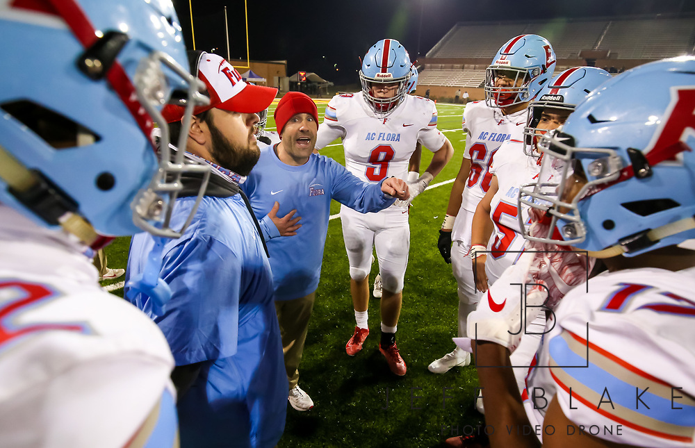 AC Flora Falcons head coach Dustin Curtis directs his team during a timeout in the second half of the state championship game against the North Myrtle Beach Chiefs at Benedict College.