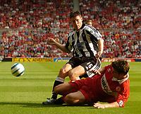 Photo. Jed Wee.Digitalsport<br /> Middlesbrough v Newcastle United, Barclays Premiership, 14/08/2004.<br /> Newcastle's James Milner (L) is bundled over by Middlesbrough's Chris Riggott.
