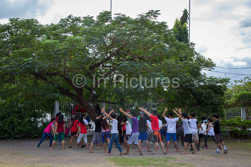 Children practicing dance moves on the grounds of the Aguinaldo Shrine in Kawit, Cavite, the Philippines.