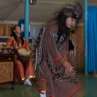 A Mongolian dancer performs a 'shaman dance' at a tourist ger camp by Lake Hovsgol in Lake Hovsgol National Park.