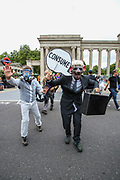 This is a theatrical performance featuring the fossil fuel industry's influence in media and politics. Climate change demonstrators from environmental activist group Extinction Rebellion kick-started their 4th day on Thursday, Aug 26, 2021. (VX Photo/ Vudi Xhymshiti)