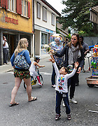 Families blow bubbles in Appenzell village, Switzerland, Europe. Frescoes decorate many of the buildings which date from the 1500s. The solid red building in the background is the Rathaus (built 1560-83), which houses the city hall, Appenzell Museum, tourist office and library, on Hauptgasse (Main Street). Appenzell Innerrhoden is Switzerland's most traditional and smallest-population canton (second smallest by area). For licensing options, please inquire.