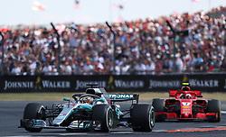 Mercedes' Lewis Hamilton (left) and Ferrari's Kimi Raikkonen during the 2018 British Grand Prix at Silverstone Circuit, Towcester.