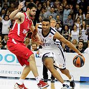 Anadolu Efes's Joshua Shipp (R) during their Turkish Airlines Euroleague Basketball playoffs Game 3 Anadolu Efes between Olympiacos at Abdi ipekci Arena in Istanbul, Turkey, Wednesday, April 17, 2013. Photo by Aykut AKICI/TURKPIX