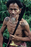 1989: Nomadic Penan native with blowpipe, wispy beard and mustache. Belaga district, Sarawak, Borneo<br /> <br /> Tropical rainforest and one of the world's richest, oldest eco-systems, flora and fauna, under threat from development, logging and deforestation. Home to indigenous Dayak native tribal peoples, farming by slash and burn cultivation, fishing and hunting wild boar. Home to the Penan, traditional nomadic hunter-gatherers, of whom only one thousand survive, eating roots, and hunting wild animals with blowpipes. Animists, Christians, they still practice traditional medicine from herbs and plants. Native people have mounted protests and blockades against logging concessions, many have been arrested and imprisoned.