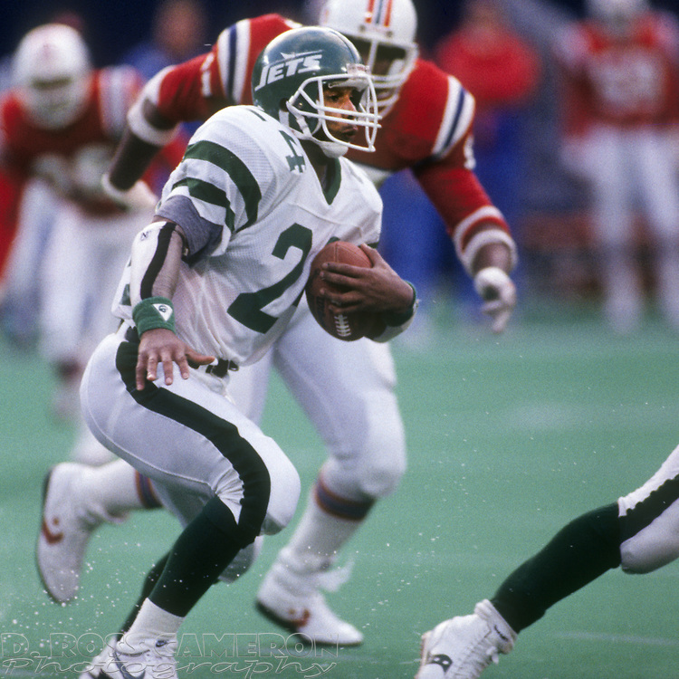 New York Jets running back Freeman McNeil (24) looks for an open lane during an NFL football game against the New England Patriots, Sunday, Nov. 13, 1988 at Giants Stadium in East Rutherford, N.J. The Patriots won 14-13. (Photo by D. Ross Cameron)