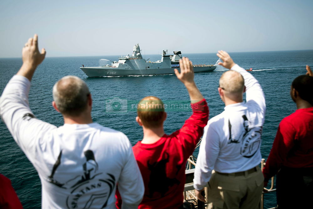 ARABIAN GULF (May 5, 2017) Sailors wave to the Danish frigate HDMS Peter Willemoes (F 362) as it departs the Arabian Gulf aboard the aircraft carrier USS George H.W. Bush (CVN 77) (GHWB). GHWB is deployed in the U.S. 5th Fleet area of operations in support of maritime security operations designed to reassure allies and partners, and preserve the freedom of navigation and the free flow of commerce in the region. (U.S. Navy photo by Mass Communication Specialist 3rd Class Christopher Gaines/Released)170505-N-YL257-188<br /> Join the conversation:<br /> http://www.navy.mil/viewGallery.asp<br /> http://www.facebook.com/USNavy<br /> http://www.twitter.com/USNavy<br /> http://navylive.dodlive.mil<br /> http://pinterest.com<br /> https://plus.google.com