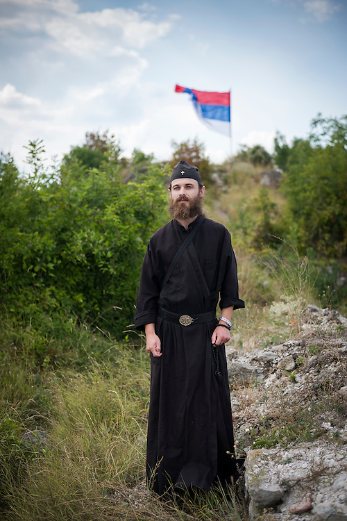 Yakov, born 1979 in Teslić, Bosnia and Herzegovina, stands at the Zvečan Fortress near Mitrovica, Kosovo. He had been a solider in the Republika Srpska army in Bosnia for five years (after the fighting had ended) and began reading Christian books during that time and felt the pull to become a monk. He wanted to be in Kosovo where, he said, his people are suffering; he would not want to be in some cushy location where there is no risk. (August 30, 2013)