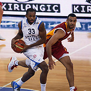 Anadolu Efes's Oliver Lafayette (L) and Galatasaray's Joshua Ian Shipp (R) during their Turkish Basketball League match Anadolu Efes between Galatasaray at Abdi Ipekci Arena in Istanbul, Turkey, Wednesday, January 04, 2012. Photo by TURKPIX