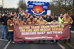 © Licensed to London News Pictures.  09/12/2014. AYLESBURY, UK. Thousands of fire fighters march through Aylesbury during the latest  nationwide strike of Fire Brigade Union members over pension rights. the union is also intending to take legal action over the dismissal of Ricky Matthews by the Buckinghamshire and Milton Keynes Fire Authority for taking part in pervious industry action. <br /> <br /> In this picture: Matt Wrack, FBU general secretary (3rd left holding banner)<br /> <br /> Photo credit: Cliff Hide/LNP
