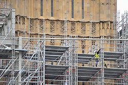 © Licensed to London News Pictures. 21/08/2017. London, UK. London, UK.  21 August 2017.  Workmen on scaffolding outside the tower. Big Ben, the bell inside the clock tower known as The Elizabeth Tower, will be silenced ahead of four years of restoration work to the glass on the clock face, the hands of the clock and the tower itself.  One clock face will continue to show the correct time throughout the renovations, driven by a temporary electric motor.  It is planned that the clock will be restarted for Big Ben to chime at New Year, on Remembrance Sunday and other special occasions.  Photo credit : Stephen Chung/LNP
