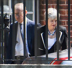 © Licensed to London News Pictures. 23/05/2019. London, UK. British PM THERESA MAY and her husband PHILIP (left) are seen leaving Downing Street. Today UK citizens will controversially go to the polls in the European elections, three years after a majority voted to leave the EU. Photo credit: Ben Cawthra/LNP