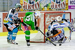 John Hughes (HDD Tilia Olimpija, #72) vs Alex Westlund (EHC Liwest Linz, #32) during ice-hockey match between HDD Tilia Olimpija and EHC Liwest Black Wings Linz in 51st Round of EBEL league, on Februar 5, 2012 at Hala Tivoli, Ljubljana, Slovenia. (Photo By Matic Klansek Velej / Sportida)