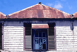House with JLP On Window