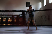 Otgontulga Rentsen of Mongolia shadow boxes in the octagon at Jackson Wink MMA in Albuquerque, New Mexico on June 9, 2016.