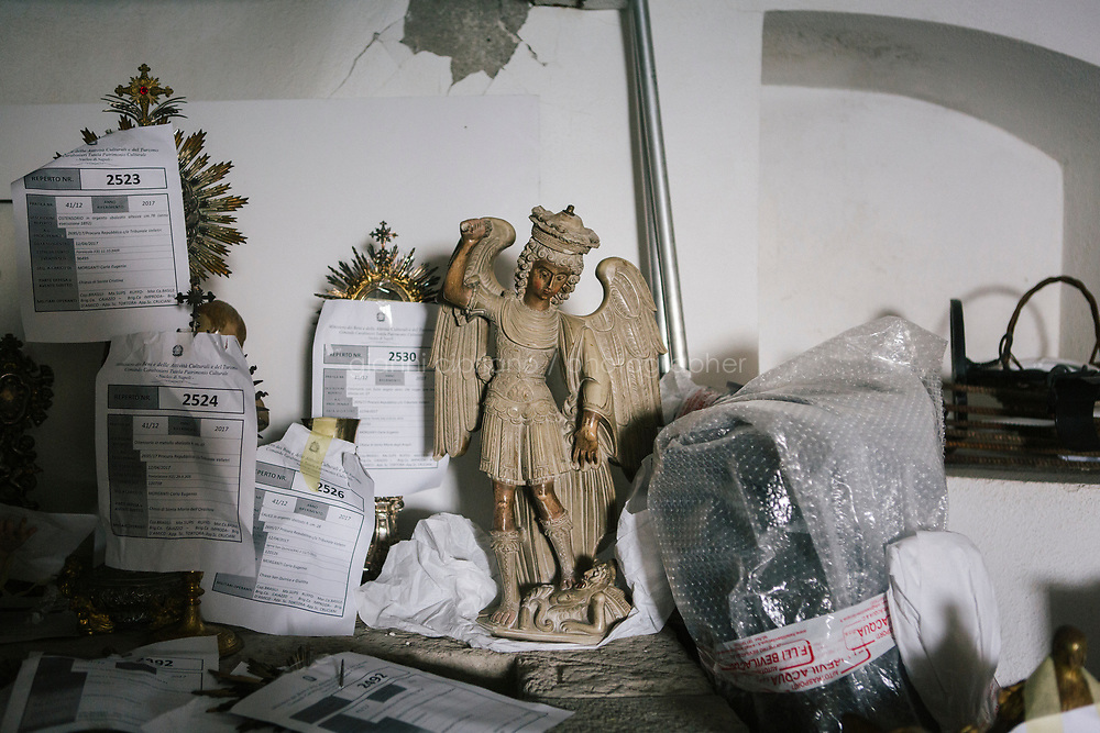 NAPLES, ITALY - 29 SEPTEMBER 2017: The 15th century statue of Saint Michael Archangel, stolen from the church of Monteroduni, is seen here in the deposit of the Commando Carabinieri Tutela Patrimonio Culturale (Command of Carabinieri for the Safeguard of Cultural eritiage, or CCTPC) together with other religious artifacts recovered after months of investigations, in Naples, Italy, on September 29th 2017.<br /> <br /> The 14th century statue of Saint Michael Archangel, stolen from the church of Monteroduni in  January 2016, is among more than 100 stolen valuable religious artifacts worth more than 7 million euros recovered by the Commando Carabinieri Tutela Patrimonio Culturale (Command of Carabinieri for the Safeguard of Cultural Heritage), or CCTPC. The operation was led by Paolo Albano, prosecutor of Isernia. It was returned to the church and population of Monteoroduni after several months of investigation.