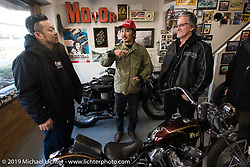 Go Takamine (red hat) with Harley-Davidson's design team led by Ray Drea (Rt of Go) during their visit to Go's Brat Style shop. Tokyo, Japan. Monday, December 8, 2014. Photograph ©2014 Michael Lichter.
