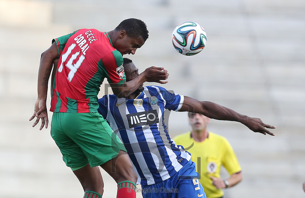 """Portugal, Funchal, Madeira : Maritimo's Cape Verdean defender Admilson de Barro """"Gege"""" (L) vies with FC Porto's Colombian forward Jackson Martinez during the Portuguese league football match CS Maritimo vs FC Porto at the Dos Barreiros stadium in Funchal on February 1, 2014. AFP PHOTO/ GREGORIO CUNHA"""