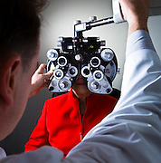 An optometrist examines a patient's visual acuity.