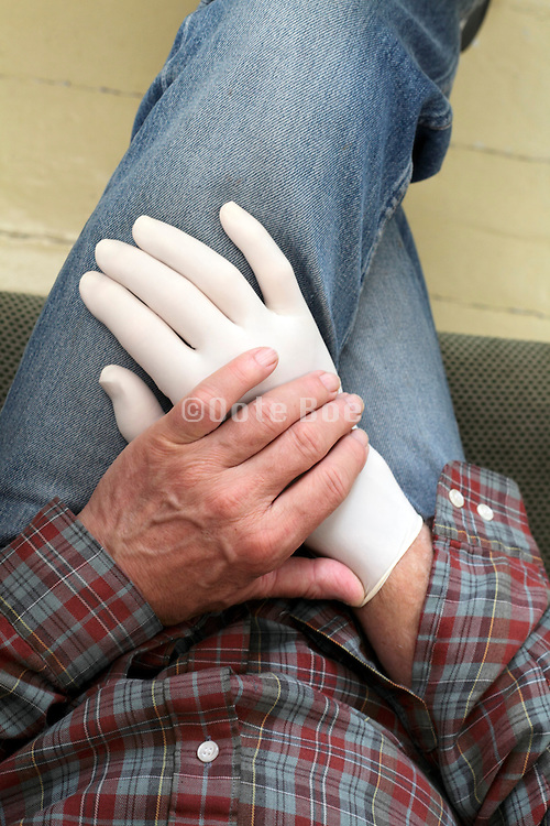 man with one rubber glove