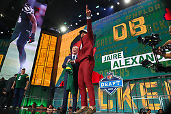 April 26, 2018 - Arlington, TX, U.S. - ARLINGTON, TX - APRIL 26:  Jaire Alexander points up to the crowd after taking photos with NFL Commissioner Roger Goodell after being chosen by the Green Bay Packers with the 18th pick during the first round at the 2018 NFL Draft at AT&T Statium on April 26, 2018 at AT&T Stadium in Arlington Texas.  (Photo by Rich Graessle/Icon Sportswire) (Credit Image: © Rich Graessle/Icon SMI via ZUMA Press)