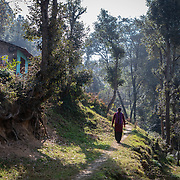 Gudiya Khan, a member of the women's knitting circle, walks to her home, located about 10km from Ranikhet, India, on Dec. 4, 2018.