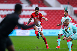 Watched by the assistant referee, Tobias Figueiredo of Nottingham Forest lofts the ball forwards - Mandatory by-line: Nick Browning/JMP - 29/11/2020 - FOOTBALL - The City Ground - Nottingham, England - Nottingham Forest v Swansea City - Sky Bet Championship