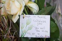 © Licensed to London News Pictures . FILE PICTURE DATED 12/07/2013 of flowers and tributes at the scene on Beard Road , Gorton , Greater Manchester where 23 year old Jordan Begley died following an incident in which he was tasered by police . The inquest is taking place today ( 1st June 2015 ) at Manchester Civil Justice Centre . Photo credit : Joel Goodman/LNP