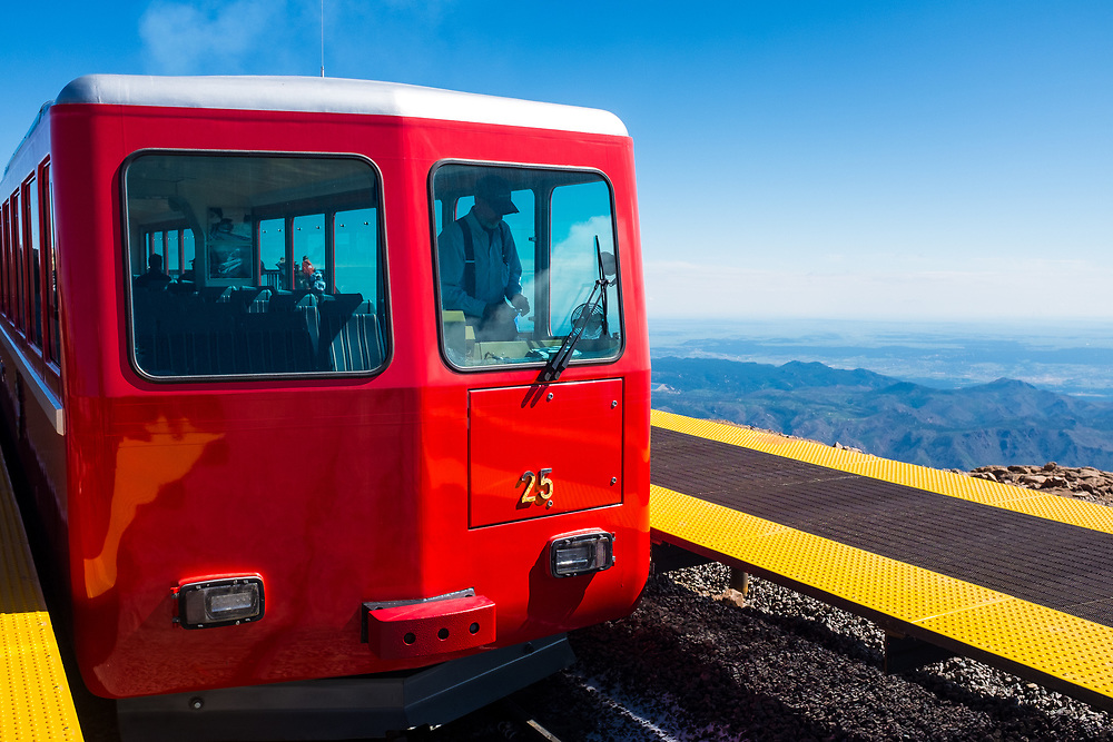 The Pikes Peak Cog Railway prepares for departure at an elevation of 14,115 feet above sea level.
