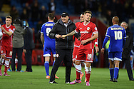 Cardiff city manager Russell Slade celebrates with Anthony Pilkington (19) at end of game after his team win 3-1. Skybet football league championship match, Cardiff city v Ipswich Town at the Cardiff city stadium in Cardiff, South Wales on Tuesday 21st October 2014<br /> pic by Andrew Orchard, Andrew Orchard sports photography.