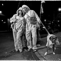 Young couple dressed in a fisherman theme on the streets of Greenwich Village, during Halloween, in NYC.