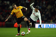 Scot Bennett of Newport County (L) puts the boot in to tackle Erik Lamela of Tottenham Hotspur (R). The Emirates FA Cup, 4th round replay match, Tottenham Hotspur v Newport County at Wembley Stadium in London on Wednesday 7th February 2018.<br /> pic by Steffan Bowen, Andrew Orchard sports photography.