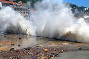 WENLING, CHINA - AUGUST 07: (CHINA OUT) <br /> <br /> Tourists look high waves at Shitang Town as Typhoon Soudelor approaches on August 7, 2015 in Wenling, Zhejiang Province of China. Typhoon Soudelor will land on southeastern China's coastal areas early Saturday, according to meteorological departments. <br /> ©Exclusivepix Media